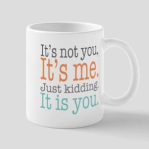 It's Not Me Just Kidding III Mugs