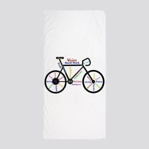 Bike made up of words to motivate Beach Towel