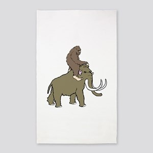 Bigfoot riding a woolly mammoth Area Rug