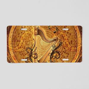 Golden harp on wonderful vintage background Alumin