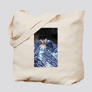Its in blue Tote Bag