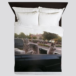 four Siberian huskies in green Dodge p Queen Duvet