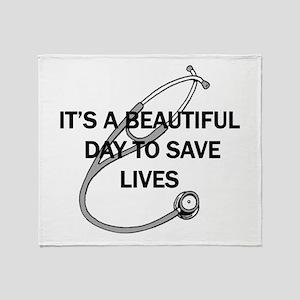 Saving Lives Throw Blanket