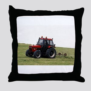 A Red Tractor On The Go Throw Pillow