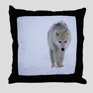 Arctic wolf walking in the snow Throw Pillow
