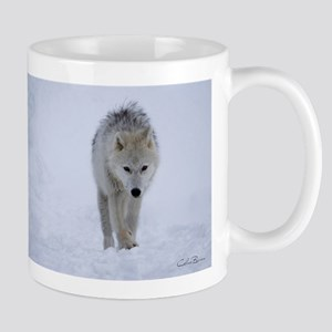 Arctic wolf walking in the snow Mugs