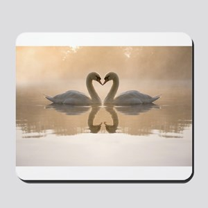 White swan in the foggy lake at the dawn Mousepad
