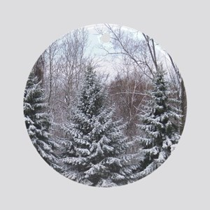 Snow covered pine Round Ornament