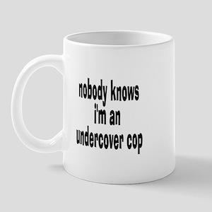 NOBODY KNOWS I'M AN UNDERCOVE Mug