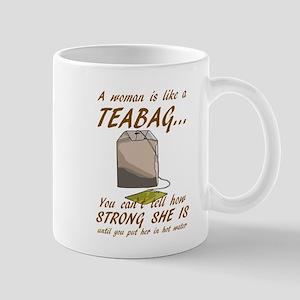 S WOMAN IS LIKE A TEA BAG... Mugs