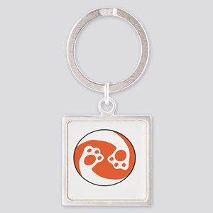 animal paws in a circle symbol - orange Keychains