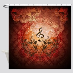 Music, clef with floral elements on antique backgr
