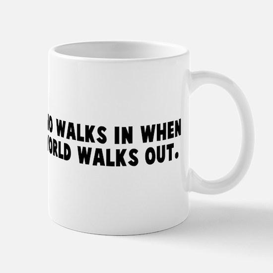 A friend is one who walks in  Mug