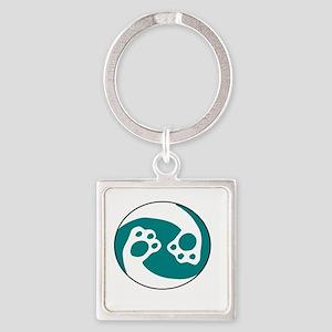 animal paws in a circle symbol - aqua Keychains