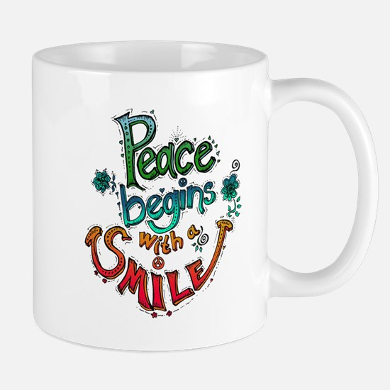 PEACE BEGINGS WITH A SMILE Mugs