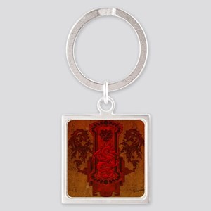 Chinese draon on button in red colors Keychains