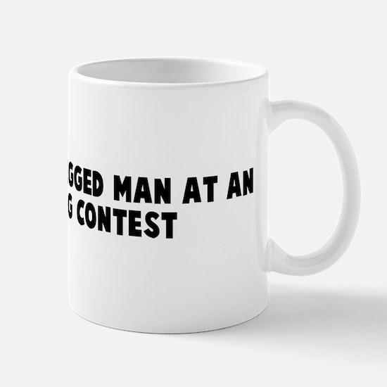 Busy as a one legged man at a Mug