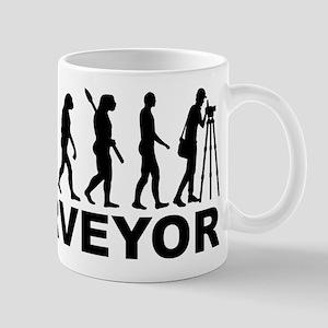 Evolution surveyor Mugs
