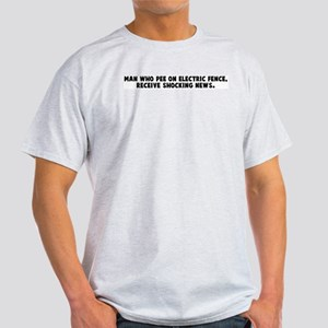 Man who pee on electric fence Light T-Shirt