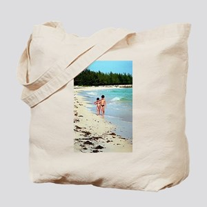 Brother and sister walking on the beach h Tote Bag