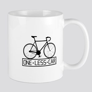 One Less Car Mugs