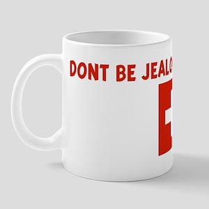 DONT BE JEALOUS I AM SWISS Mug