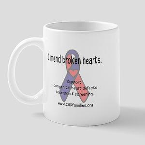 I mend broken hearts Mug