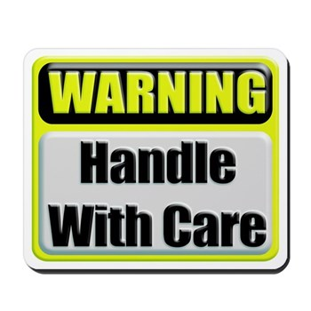 Handle With Care Warning Mousepad