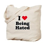 I love being hated Tote Bag