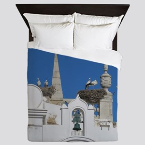 storks build nests on the church in th Queen Duvet