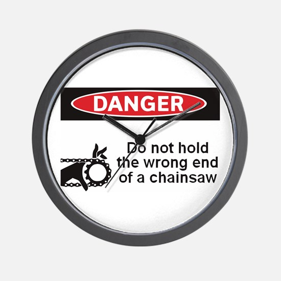 Danger. Do not hold the wrong Wall Clock