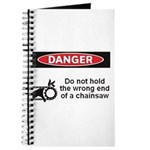 Danger. Do not hold the wrong Journal