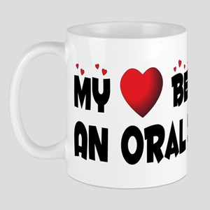 Belongs To An Oral Surgeon Mug