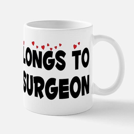 Belongs To An Oral Surgeon Mug