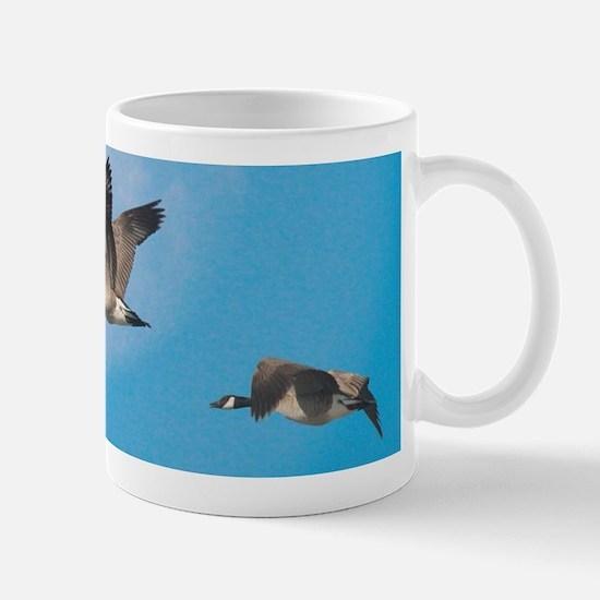 Geese over moon Mugs