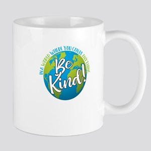 In a world where you can be anything, be kind Mugs