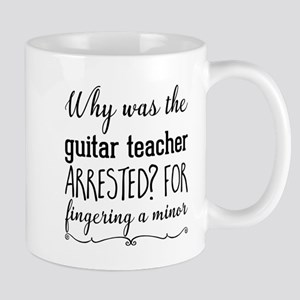 Why was the guitar teacher arrested? For fing Mugs