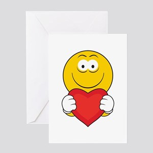 Smiley Face Holding Heart Greeting Card