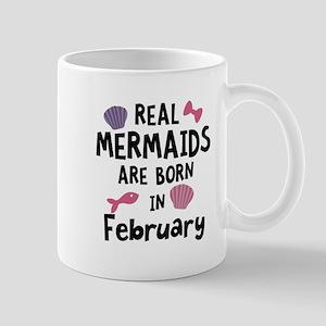 Mermaids are born in February C0w2q Mugs