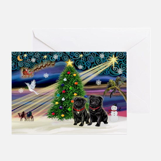 Xmas Magic & 2 Black Pugs Greeting Card