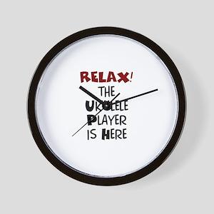 ukulele player here Wall Clock