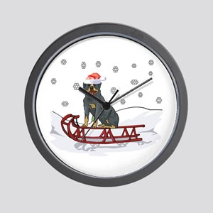 Sledding Rottweiler Wall Clock