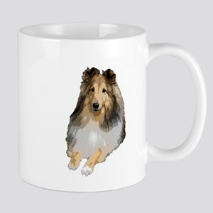 Sheltie lying down Mugs