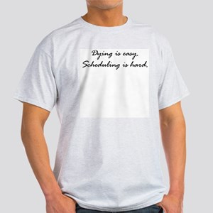 Dying is easy. Scheduling... Light T-Shirt