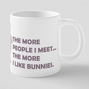 THE MORE PEOPLE I MEET THE MO Mugs