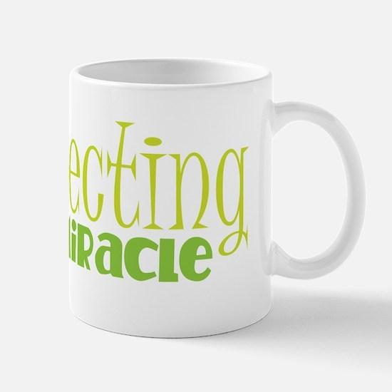 Expecting a miracle GREEN Mugs