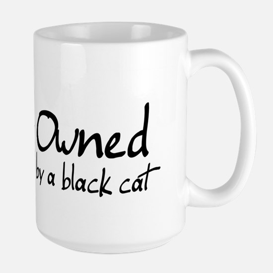 owned by a black cat Large Mug