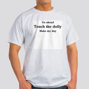 Go ahead. Touch the dolly. Light T-Shirt