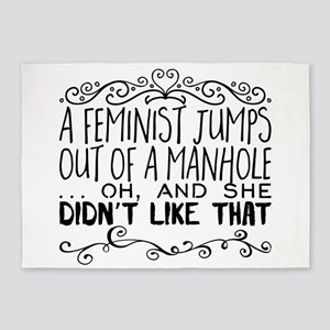 A feminist jumps out of a manhole … 5'x7'Area Rug