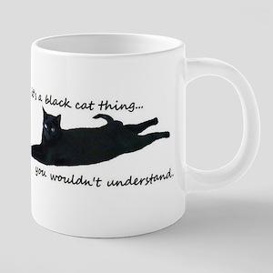 black cat thing Mugs
